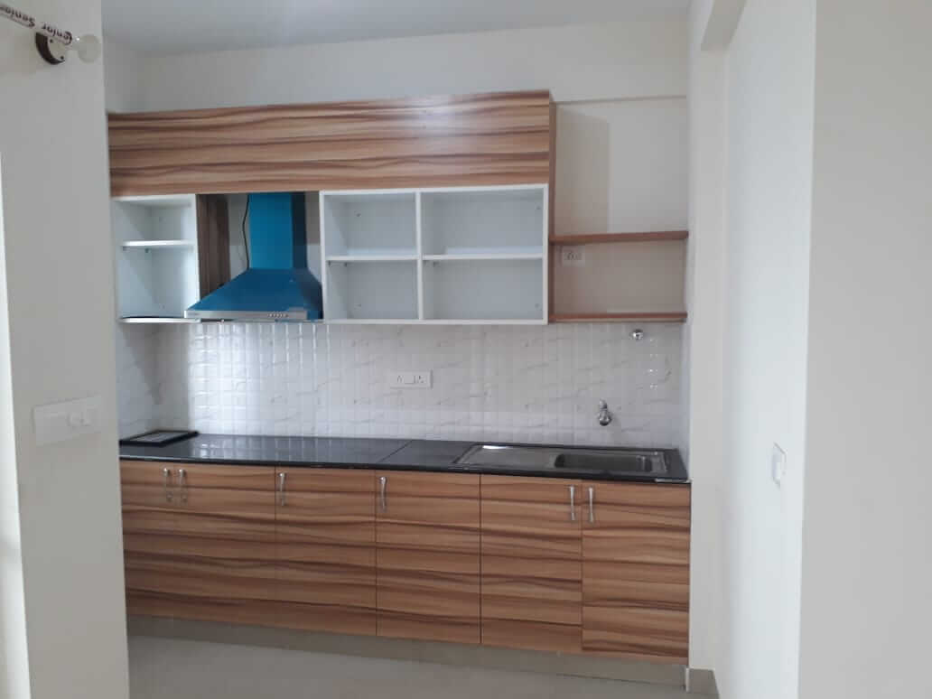 2bhk with wardrobe and kitchen cabinet , 24hrs water and security, car and 3 wheeler parking