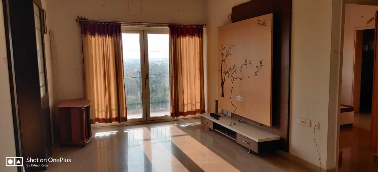 Semi furnished two bhk with study room flat for rent in gated community